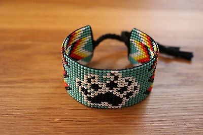 Native American Seed Bead Bracelet.  Four Colors Bear Paw.