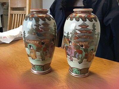 A stunning pair of antique hand painted Meiji period satsuma vases, signed