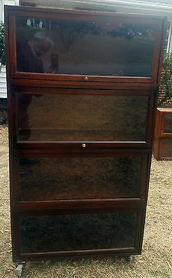 4 section walnut lawyer/barrister bookcase with castors