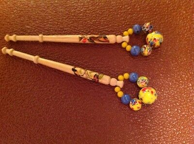 pair of wooden lace bobbins lacemaking bird picture