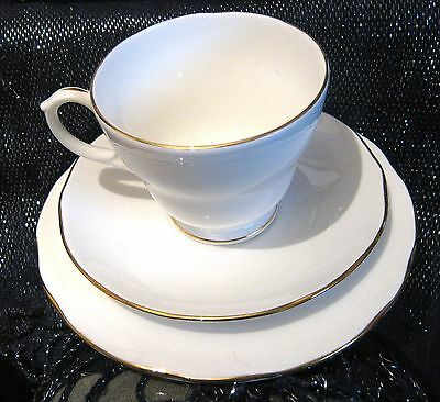 Duchess bone china trio in white with gilding edges very nice items.