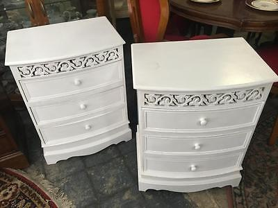 Pair Of White Hamptons / French Style Carved 3 Drawer Bedside Cabinets