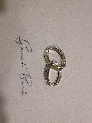 Amore Wedding Guest Book In Cream Suade Type Material With Ring Motif