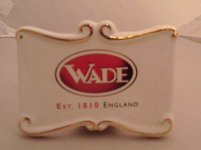 Wade pottery makers sign for cabinet display