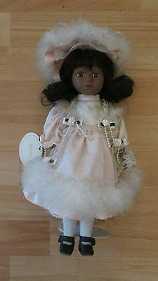 """12"""" Collectable Doll called Megan from Doll of Distinction on removable stand"""