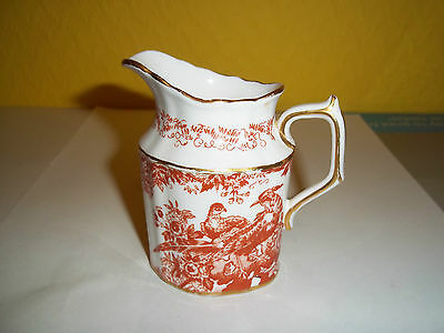 Royal Crown Derby china milk jug in the Red Aves pattern. A/F chipped