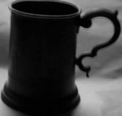 Intriguing Victorian 1/2 Pint Tankard with inscribed military scene on surface.