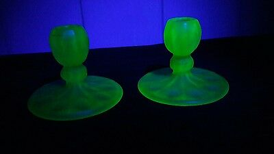 A pair of frosted uranium glass candlesticks