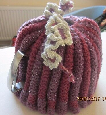 Vintage style knitted tea cosy;pink & mauve; lurex trim flowers; fits large pot