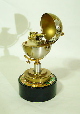 Collectable lighter inside a rotating globe on top of a music box by Windmill