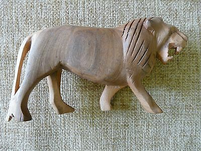 Hand-Carved Wooden Lion Figurine From South Africa