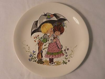 Poole plate with a boy & girl under an umbrella signed Gottschlict.