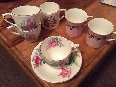 bone china coffe cups and one saucer