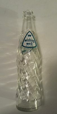 """Canadian (Toronto, Ont) """"wishing Well"""" 10 Oz Clear Embossed Bottle-Bluish/white"""
