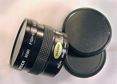 Fisheye lens for Olympus OM (49mm screw). Cased with both caps. Excellent.
