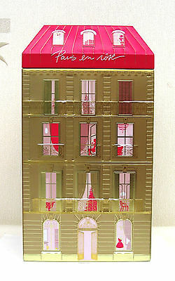 A Pair Of Lancome Ltd Edition tins of Hausmannian building from central Paris