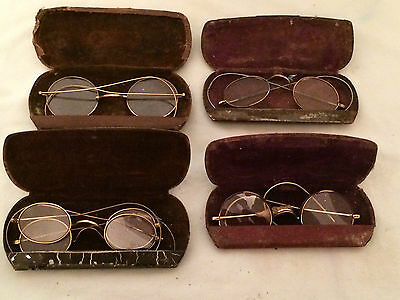 Vintage spectacles and cases.