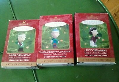 Hallmark ornaments Charlie Brown Lucy Linus