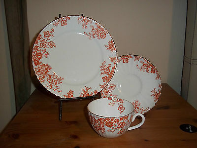 Antique Radford bone china cup, saucer, plate trio in white and rust red. used.