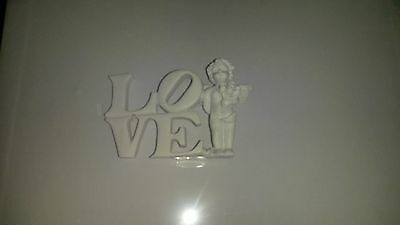 ceramic love sign cherub and flowers in white. .. Valentines gift