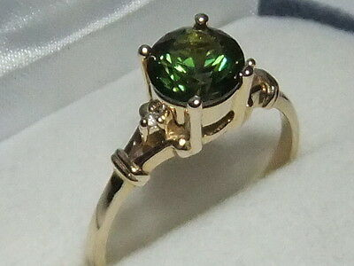 Solid 9 carat gold ladies ring with round 7mm natural Australian green sapphire