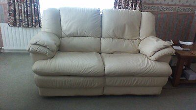 Two seater soft leather recliner sofa.