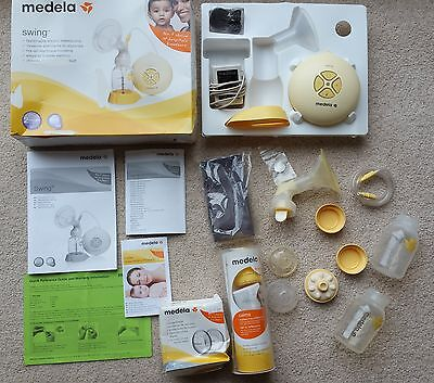 Boxed Medela Swing single electric breast pump with calma and other extras.