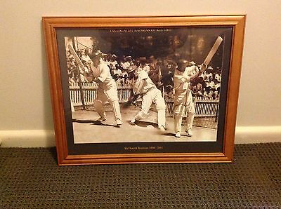 Framed action photo montage of Sir Donald Bradman.