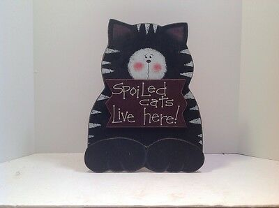 Spoiled cats live here! wooden sign.