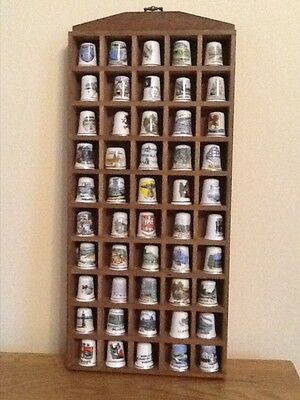Thimbles - 50 assorted thimbles with display case
