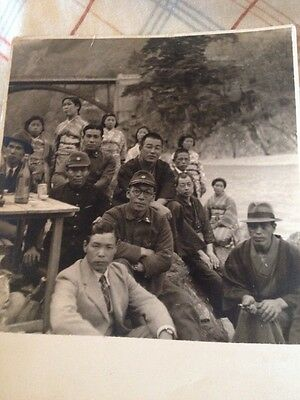 WW2 Asian Family With Soldiers