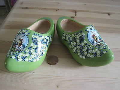 A pair of green wooden dutch cloggs