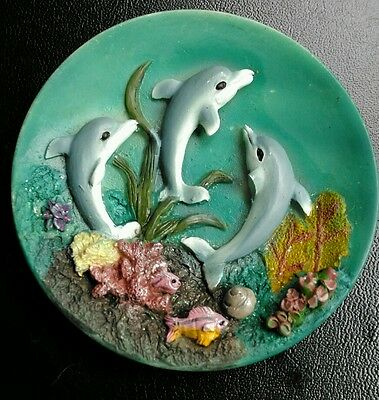 Sweet, small, Dolphin trinket dish. Nice little ornament.