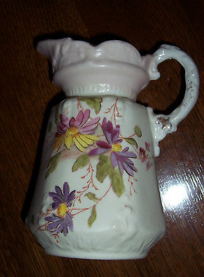 milk/cream pitcher with daisy like flowers and gold highlights