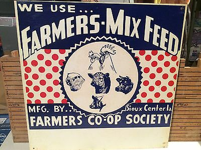 Vintage FARMERS MIX FEED metal sign from Sioux Center Iowa