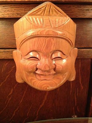 Carved wooden Budda face wall hanger