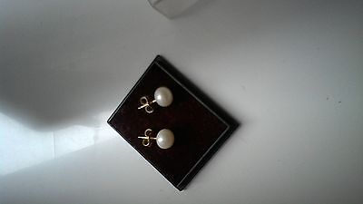 real pearl stud earrings on 14ct gold