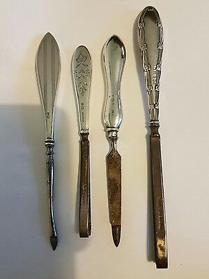 Four Antique Hallmarked Solid Silver Handled Manicure Items