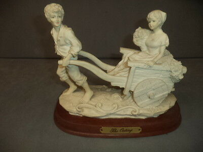 """1 beautiful figurine """" called the outing """""""