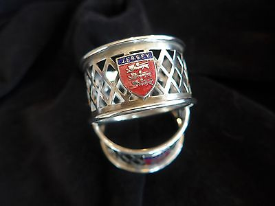 A pair of Jersey silver crested napkin rings