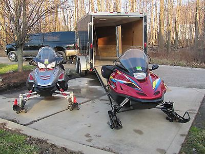 Two Yamaha Snowmobiles along with trailer as bundle deal