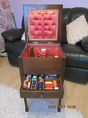 teak sewing box on legs with pullout drawer and lift up lid
