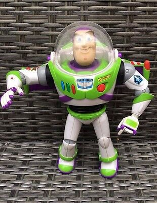 Disney Toy Story Deluxe Talking BUZZ LIGHTYEAR Light Up Jetpack & Laser & Sounds
