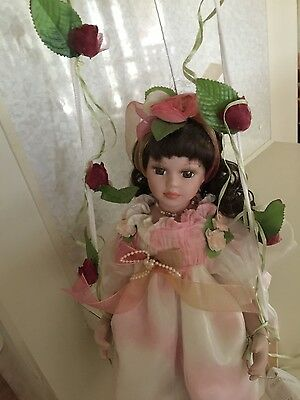 Homeart Porcelain Doll with Swing Candy