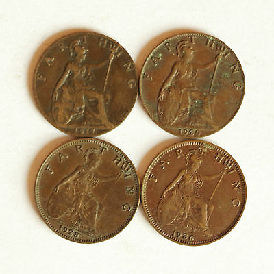Four George V farthings dated 1917, 1920, 1928 & 1936