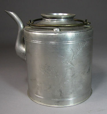 A Fine Chinese Silvered Pewter Tea Pot Incised with a Phoenix-19th C.