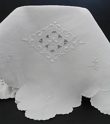 Vintage white Irish linen tablecloth with scalloped edges and hand embroidery.