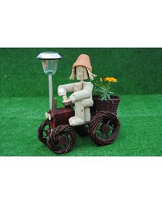 Man on small dark wika tractor with a solar light Hand Made