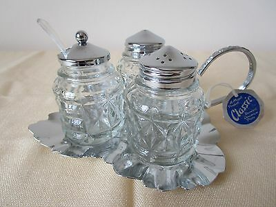 Vintage Cruet set on serving tray with spoon. Stainless Steel, British made