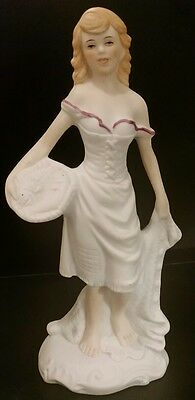 Figurine of lady in a dress